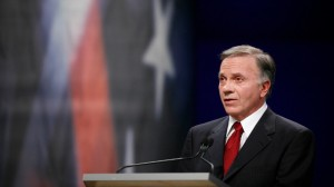 Former Rep. Tom Tancredo, R-Colo., responds during the Des Moines Register Republican Presidential Debate in Johnston, Iowa, Wednesday, Dec. 12, 2007. (AP Photo/Charlie Neibergall)
