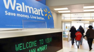 In this Feb. 17, 2009 file photo, shoppers leave a Wal-Mart in Danvers, Mass. Wal-Mart Stores Inc., the world's largest retailer, on Thursday, Jan. 28, 2010 said it is realigning its US operations in an effort to give more autonomy to executives in regional markets and reinvigorate US growth. (Photo by Lisa Poole, File/AP)
