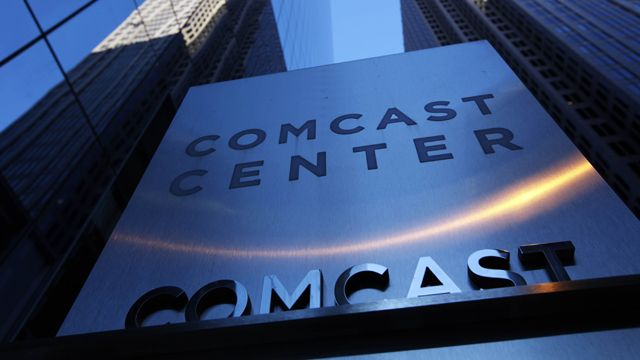 In this Dec. 3, 2009 file photo, a sign outside the Comcast Center, left, is shown in Philadelphia. (AP Photo/Matt Rourke, file)