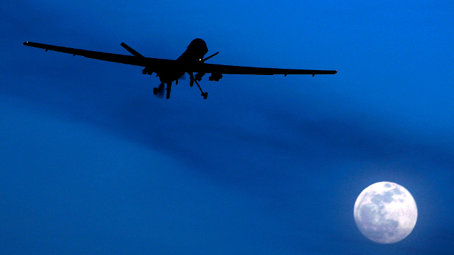 In this Jan. 31, 2010 file photo, an unmanned US Predator drone flies over Kandahar Air Field, southern Afghanistan, on a moon-lit night. (AP Photo/Kirsty Wigglesworth, File)