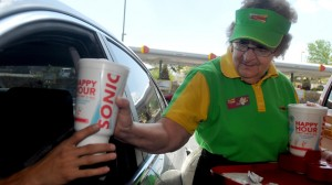 Dora Farmer, 70, a carhop at Sonic Drive-In in Las Cruces, NM, fills a customer's order. (AP Photo/Las Cruces Sun-News, Norm Dettlaff)