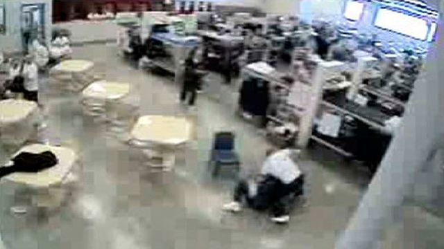 In a frame grab from video obtained by The Associated Press, an inmate attacks fellow inmate Hanni Elabed at the privately-run Idaho Correctional Center just south of Boise, Idaho. Elabed suffered brain damage and persistent short-term memory loss after he was beaten by inmate James Haver while multiple guards watched at the Idaho prison operated by Corrections Corporation of America. (AP Photo)