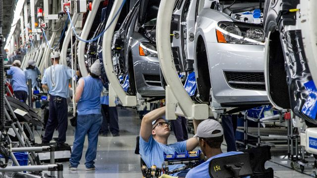 Workers assemble Volkswagen Passat sedans at the German automaker's plant in Chattanooga, Tenn. Workers at the plant will decide in a three-day vote Wednesday, Feb. 12, 2014, whether they want to be represented by the United Auto Workers union. (AP Photo/Erik Schelzig, file)