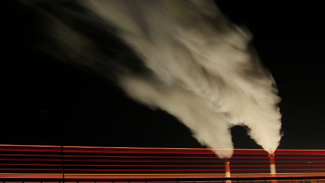 In this Jan. 19, 2012 file photo, smoke rises in this time exposure image from the stacks of the La Cygne Generating Station coal-fired power plant in La Cygne, Kan. (AP Photo/Charlie Riedel, Filr)