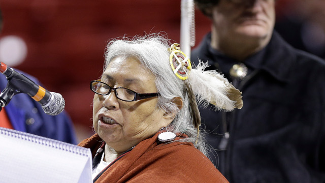 Faith Spotted Eagle, a Yankton Sioux, speaks in opposition to the Keystone XL pipeline, with Carl Hudson, Chief of the Southern Cherokee, right, awaits his turn to speak, during the U.S. State Department's sole public hearing in Grand Island, Neb., Thursday, April 18, 2013, to allow citizens to make their views known on the $7.6 billion Canada-to-Texas Keystone XL pipeline. (AP Photo/Nati Harnik)