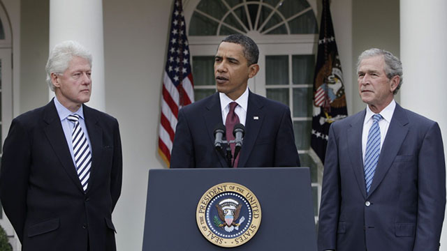 President Barack Obama, center, speaks as former Presidents Bill Clinton, left, and George W. Bush, right, listen in the Rose Garden at the White House in Washington Saturday, Jan. 16, 2010. Bush and Clinton have been asked by Obama to help with US relief efforts after the earthquake in Haiti. (AP Photo/Pablo Martinez Monsivais)
