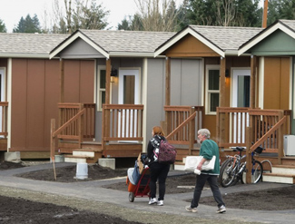 Residents of Quixote Village in Olympia, Wash., move in with their belongings. Photo courtesy of Panza.