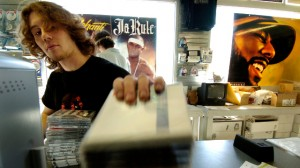 Cameron Karnes sorts CDs at Independent Records & Video March 14, 2006, in Denver. As a group, Millennials, the generation born between 1981 and 1999, are characterized as confident, hardworking and technologically fluent. (AP Photo/The Denver Post, Kathryn Osler)