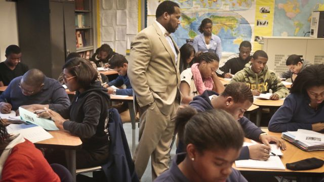 Adofo Muhammad, center, principal of Bedford Academy High School, teaches 10th and 11th graders in his Global Studies class in the Brooklyn Borough of New York. (AP Photo/Bebeto Matthews, File)