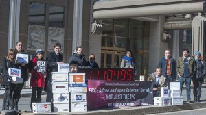 Avaaz joins with other US advocacy groups to deliver more than a million signatures for a free and democratic internet to the FCC in Washington using a giant digital counter on Thursday, Jan. 30, 2014. (Photo by Kevin Wolf/AP Images for Avaaz)