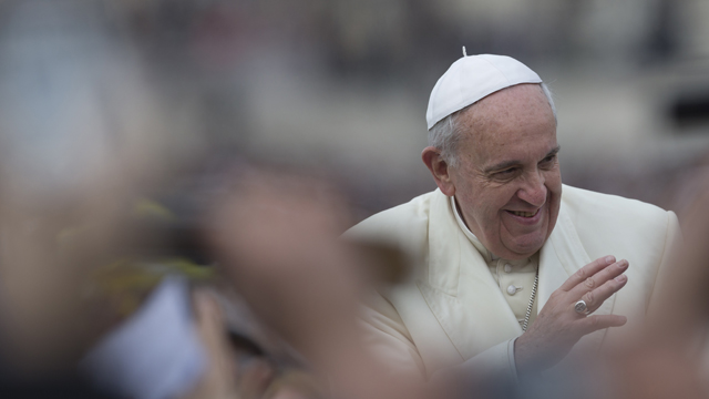 Pope Francis waves as he is driven through the crowd ahead of his weekly general audience in St. Peter's Square, at the Vatican, Wednesday, Feb. 26, 2014. (AP Photo/Felipe Dana)