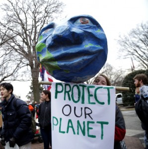 University of Pennsylvania student Emily Belshaw, holds a papier mâché Earth, designed by Spiral Q puppet theater in Philadelphia, at the Keystone XL Pipeline protest. (Photo: John Light)