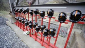 Mine helmets and painted crosses sit at the entrance to Massey Energy's Upper Big Branch coal mine Tuesday, April 5, 2011, in Montcoal, W.Va. (AP Photo/Jeff Gentner)