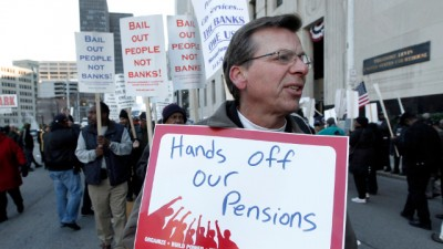 In this Oct. 23, 2013 file photo, Dennis Marton walks with protesters at a rally outside The Theodore Levin United States Courthouse in Detroit. (AP Photo/Paul Sancya, File)
