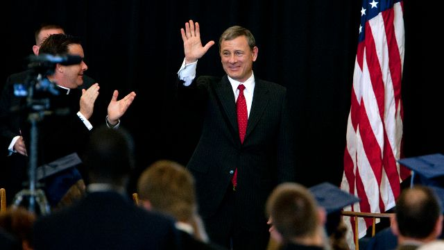 Supreme Court Chief Justice John Roberts waves after giving the commencement address on Friday, May 24, 2013, at LaLumiere School in LaPorte, Ind. (AP Photo/South Bend Tribune, James Brosher)