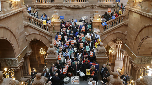 Supporters for fair elections in New York rally on the Million Dollar Staircase at the Capitol on Tuesday, March 11, 2014, in Albany, NY. (AP Photo/Mike Groll)
