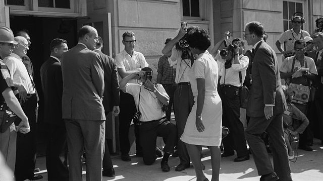 Vivian Malone Jones registered for classes at the University of Alabama on June 11, 1963. Then-Governor George Wallace, flanked by state troopers, physically blocked her entrance until federal marshals intervened. Years later, Jones' future brother-in-law, Eric Holder, would become Attorney General of the United States. (Image: Library of Congress)