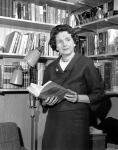 "Holding her controversial book ""Silent Spring,"" Rachel Carson stands in her library in Silver Springs, Md. on March 14, 1963. (AP Photo)"