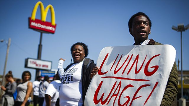 Josh Adams, right, chants with other protestors near the corner of Airways Blvd. and Lamar Ave. outside of a McDonalds in Memphis, Tenn. Thursday, May 15, 2014, while demonstrating for a $15 wage and right to form a union without retaliation in the fast food industry. (AP Photo/The Commercial Appeal, William DeShazer)