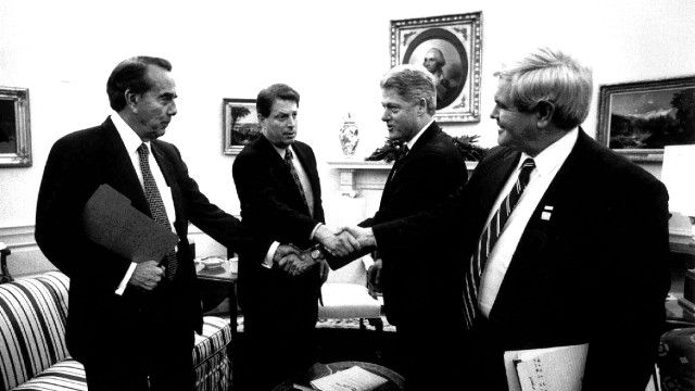 "President Clinton shakes hands with Senate Majority Leader Bob Dole of Kansas and Vice President Gore shakes hands with House Speaker Newt Gingrich of Georgia during their Oval Office meeting Tuesday Dec. 19, 1995 to discuss the federal budget impasse. Budget talks collapsed Wednesday after President Clinton scuttled an Oval office meeting with Republican leaders and accused ""the most extreme"" House Republicans of reneging on a deal that could have ended the government's partial shutdown. (AP Photo/White House)"