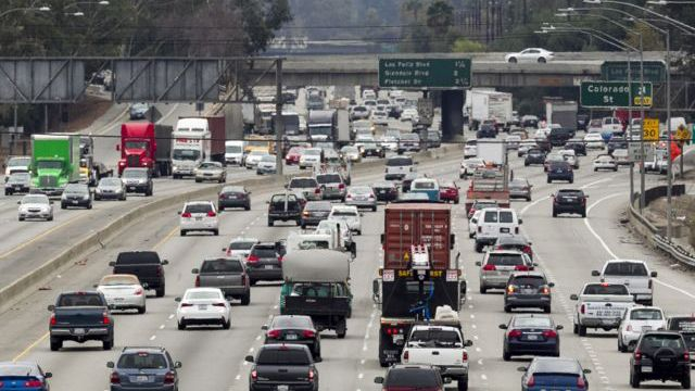 Late morning traffic travels on Interstate 5, Los Angeles in this Thursday, February 6, 2014 photo. (AP Photo/Damian Dovarganes)