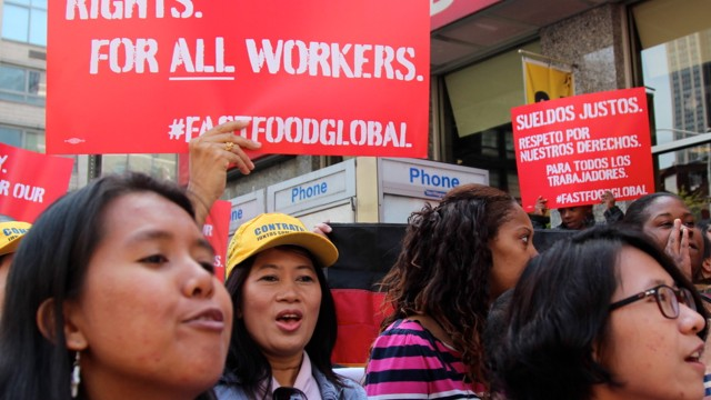 Fast food workers announce a global protest for a higher minimum wage outside a McDonald's restaurant in Manhattan on May 7, 2014. (BillMoyers.com/Neha Tara Mehta)
