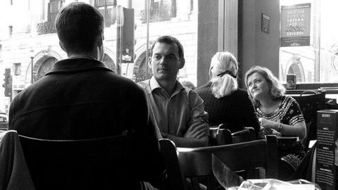 People talking in a cafe (Flickr)
