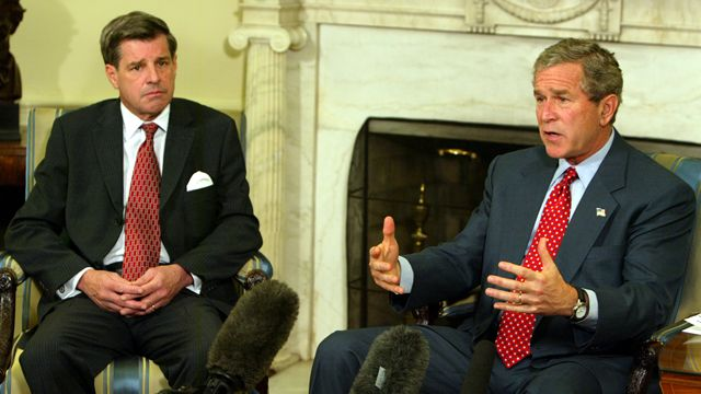 President Bush, right, speaks to reporters during his meeting with L. Paul Bremer, the top U.S. administrator in Iraq, in the Oval Office at the White House Monday, Oct. 27, 2003 in Washington. (AP Photo/Charles Dharapak)