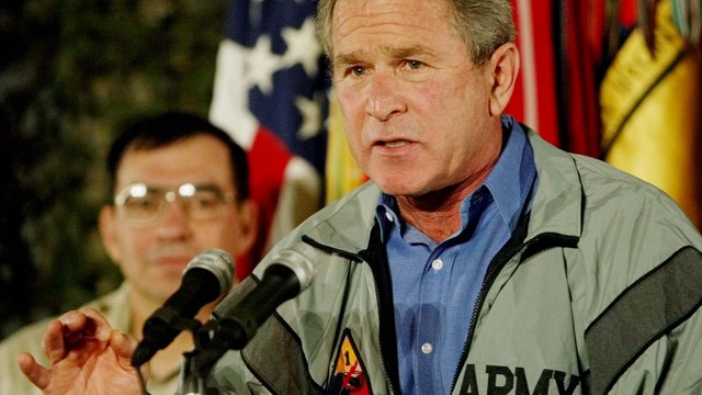 President George W. Bush speaks to US troops, Nov. 27, 2003, in Baghdad, Iraq. (AP Photo/Pablo Martinez Monsivais)