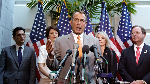 House Speaker John Boehner of Ohio, center, joined by other House GOP leaders, gestures during a news conference on Capitol Hill in Washington, Wednesday, June 27, 2012. (AP Photo/J. Scott Applewhite)