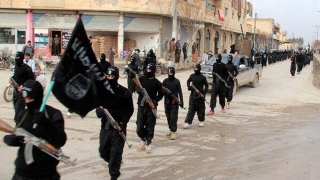 This undated file image posted on a militant website on Tuesday, Jan. 14, 2014 shows fighters from the Islamic State of Iraq and the Levant (ISIL) marching in Raqqa, Syria. (AP Photo/Militant Website, File)