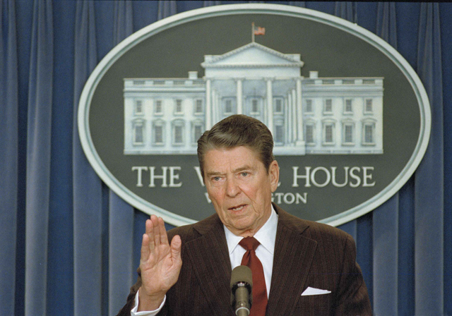 """US President Ronald Reagan tells reporters that """"I'M not taking any more questions,"""" during a news conference in the White House briefing room, Nov. 25, 1986. The news conference was on the mounting controversy over his decision to sell arms to Iran. Reagan announced to reporters the resignation of national security adviser Vice Adm. John Poindexter and the firing of Poindedxter's aide Lt. Col. Oliver North. (AP Photo/Bob Dougherty)"""