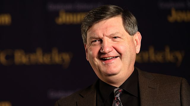 """Reporter James Risen speaks to a television reporter prior to the """"Prosecuting the Press"""" event at the UC Berkeley Graduate School of Journalism in Berkeley, California, on Thursday, November 14, 2013."""