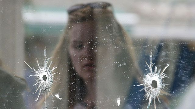 Isla Vista shooting, woman behind glass with bullet holes.