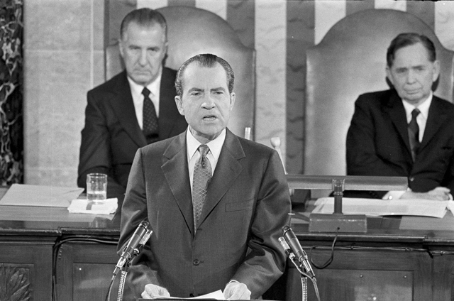President Richard M. Nixon delivers his State of the Union message to a joint session of Congress in the nation's capital, Washington, DC, Jan. 22, 1971. Behind the president are Vice President Spiro Agnew, left, and House Speaker Carl Albert. (AP Photo)
