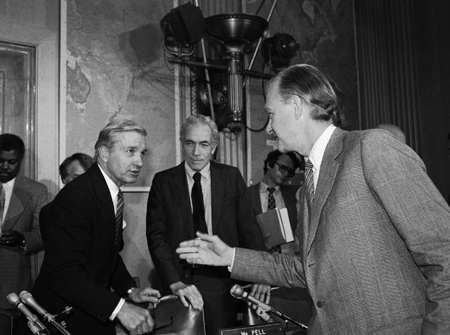 Assistant Secretary of State Thomas Enders, right, is greeted by Chairman Charles Percy of the Senate Foreign Relations Committee and fellow member Claiborne Pell, D-R.I., Tuesday, April 12, 1983 in Washington as the committee prepared to meet concerning the US policy toward Nicaragua. (AP Photo/Ron Edmonds)