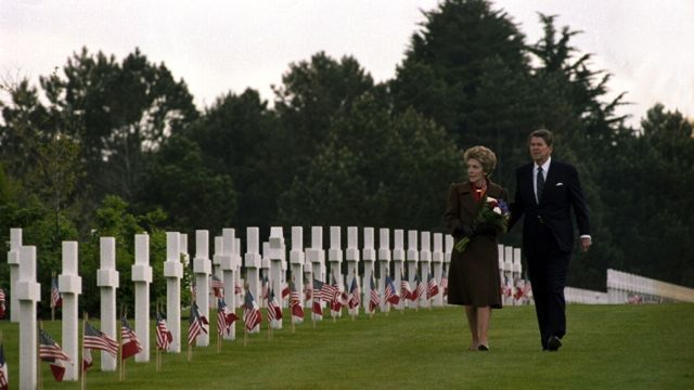 U.S. President Ronald Reagan and his wife, first lady Nancy Reagan, walk past the graves at Normandy American Cemetary in Normandy, France, June 6, 1984. The American president and first lady are attending the 40th anniversary of the allied invasion of 1944. (AP Photo/Ron Edmonds)