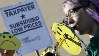 A members of the Rude Mechanical Orchestra play as they join in a protest against Wal-Mart on Black Friday, Nov 23, 2012, in Secaucus, N.J. Wal-Mart employees and union supporters are taking part in today's nationwide demonstration for better pay and benefits. A union-backed group called OUR Walmart, which includes former and current workers, was staging the demonstrations and walkouts at hundreds of stores on Black Friday, the day when retailers traditionally turn a profit for the year. (AP Photo/Mel Evans)