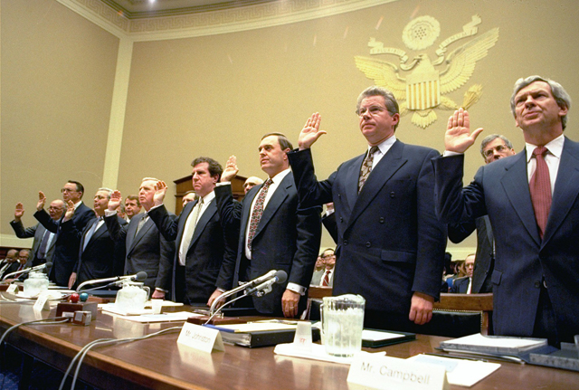 Heads of the nation's largest cigarette companies are sworn in before a House Energy subcommittee hearing on Capitol Hill, April 14, 1994. From left are: Robert Sprinkle III, executive vice president for Research American Tobacco Co.; Donald Johnston, American Tobacco; Thomas Sandefur Jr., Brown and Williamson Tobacco Corp.; Edward Horrigan Jr., Liggett Group Inc.; Andrews Tisch, Lorillard Tobacco Co.; Joseph Taddeo, US Tobacco Co.; James Johnston, RJ Reynolds; and William Campbell, Phillip Morris. In what could mark a major turning point in tobacco litigation, cigarette makers Philip Morris Cos. and RJR Nabisco are negotiating a settlement that reportedly could cost as much as $300 billion, give the companies a blanket amnesty and retire the Marlboro Man, the Associated Press learned Wednesday, April 16, 1997. (AP Photo/Johnn Duricka, File)