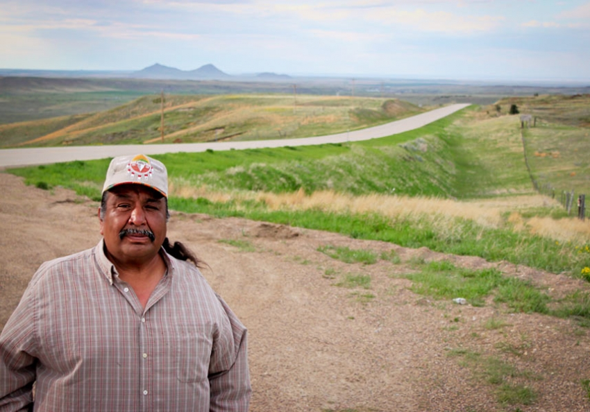 Ed 'Buster' Moore, a plaintiff in the voting-rights lawsuit Wandering Medicine v. McCulloch, stands before the southern portion of Fort Belknap, near where he lives. (Photo: Terri Long Fox/In These Times)