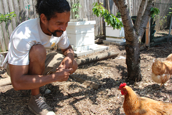 Pedro Rodriguez with several of his chickens. Photo by Kristin Moe.