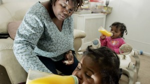 Tianna Gaines-Turner watches as her twin toddlers Marques, left, and Marianna Turner (at the time, both only one year old) have juice, Feb. 26, 2009, at their home in Philadelphia, Pennsylvania. (AP Photo/Mel Evans)