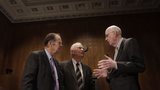 Senate Homeland Security and Governmental Affairs Committee member Sen. Robert Bennett, R-Utah, right, talks with former New jersey Gov. Thomas Kean, left, and former Indiana Rep. Lee Hamilton, on Capitol Hill in Washington, Tuesday, Jan. 26, 2010, before the committee's hearing on intelligence reform. (AP Photo/Pablo Martinez Monsivais)