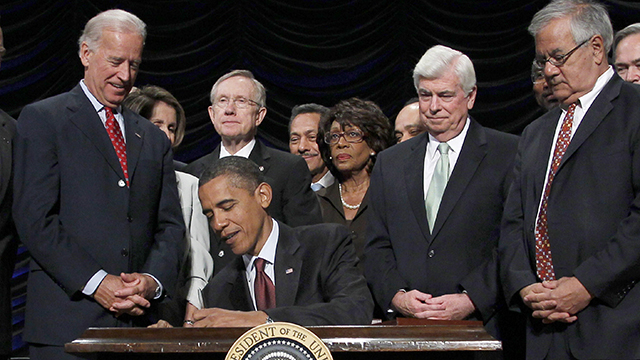 President Barack Obama, center, signs the Dodd Frank-Wall Street Reform and Consumer Protection Act in a ceremony in the Ronald Reagan Building in Washington, Wednesday, July 21, 2010.(AP Photo/Pablo Martinez Monsivais)