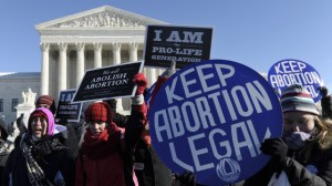 Pro-abortion and anti-abortion protestors rally outside the Supreme Court in Washington, Wednesday, Jan. 22, 2014. Thousands of abortion opponents are facing wind chills in the single digits to rally and march on Capitol Hill to protest legalized abortion, with a signal of support from Pope Francis. (AP Photo/Susan Walsh)