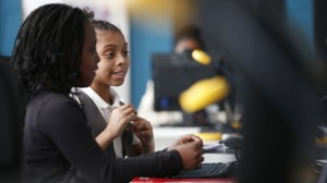 Zyheira Scroggins, 9, left, and Camaria Gray, 9, using the computer lab at the DC Promise Neighborhood Initiative (DCPNI) after-school center in the Kenilworth-Parkside neighborhood of Washington. (AP Photo/Charles Dharapak)