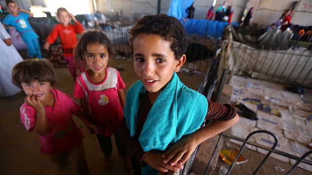 In this Wednesday July 9, 2014 photo, Iraqi refugee children from Mosul stay at a temporary camp for refugees who fled from Mosul and other towns outside Irbil, northern Iraq, nearly a month after Islamic militants took over the country's second largest city. (AP Photo)