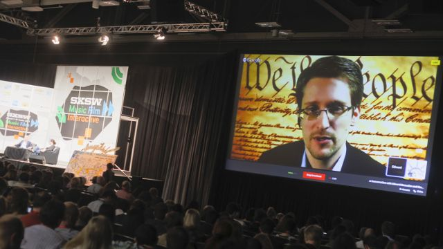 Edward Snowden talks during a simulcast conversation during the SXSW Interactive Festival on Monday, March 10, 2014, in Austin, Texas. Snowden talked with American Civil Liberties Union's principal technologist Christopher Soghoian, and answered tweeted questions. (Photo by Jack Plunkett/Invision/AP)