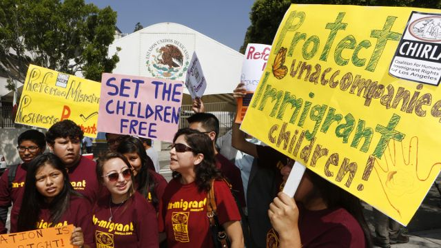 Immigration activists with Coalition for Humane Immigrant Rights of Los Angeles (CHIRLA) demand the Mexican government take more measures to protect and respect the rights of unaccompanied minors and families crossing Mexico's territory, during a protest outside the Mexican consulate in Los Angeles Thursday, July 3, 2014. Activists demand support of migrant children and families Thursday, two days after U.S. Homeland Security buses carrying the migrants were routed away from American flag-waving protesters in Murrieta, Calif., and transported to a facility in San Diego. (AP Photo/Damian Dovarganes)