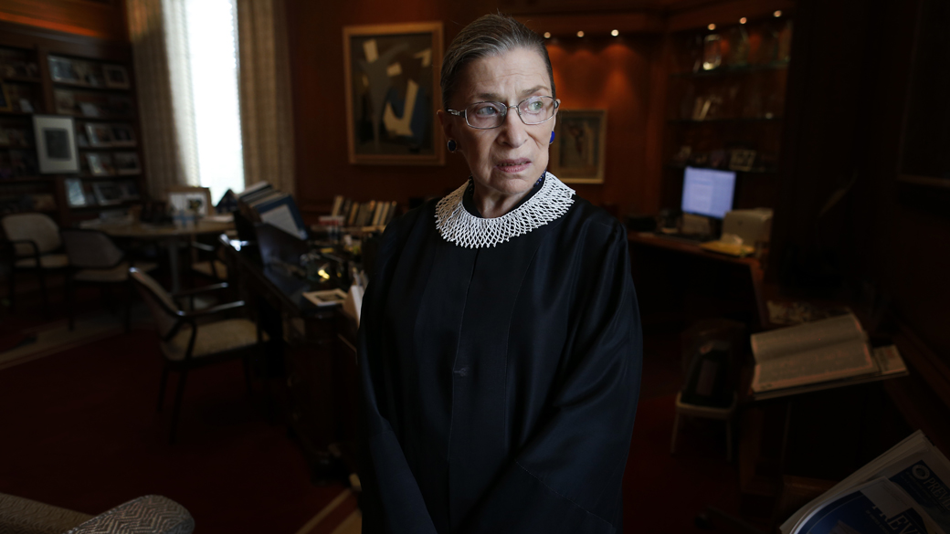 Justice Ruth Bader Ginsburg poses for a photo in her chambers at the Supreme Court in Washington, July 24, 2013. (AP Photo/Charles Dharapak)